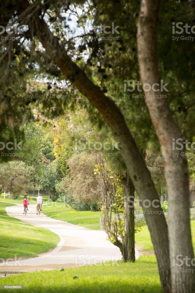 Bike ride through the gardens of Turia, Valencia, Spain stock photo