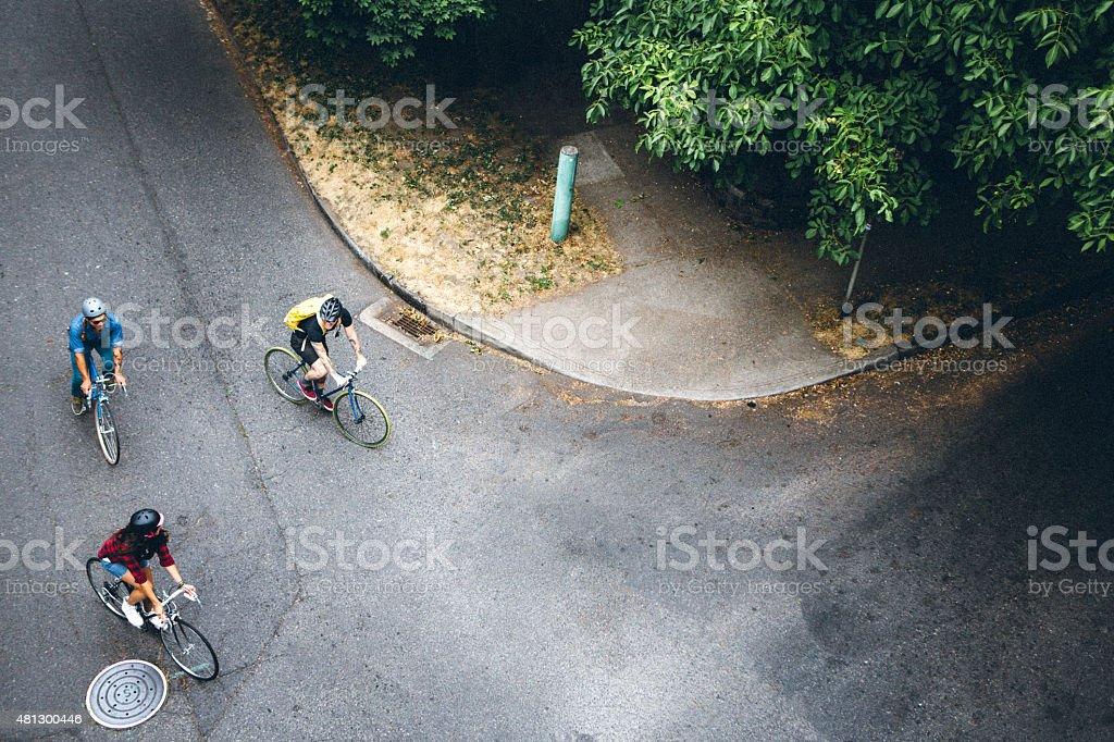 Bike Riders Overhead stock photo