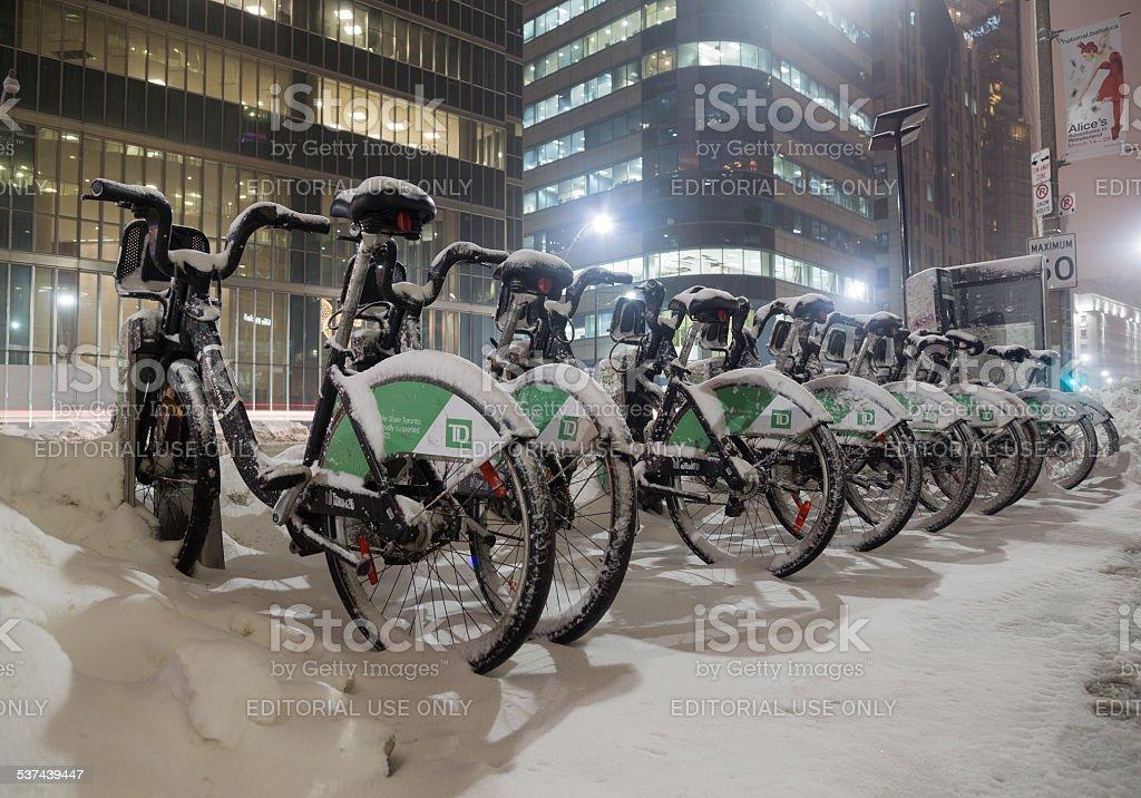 Bike Share Bikes Covered in Snow in Toronto stock photo