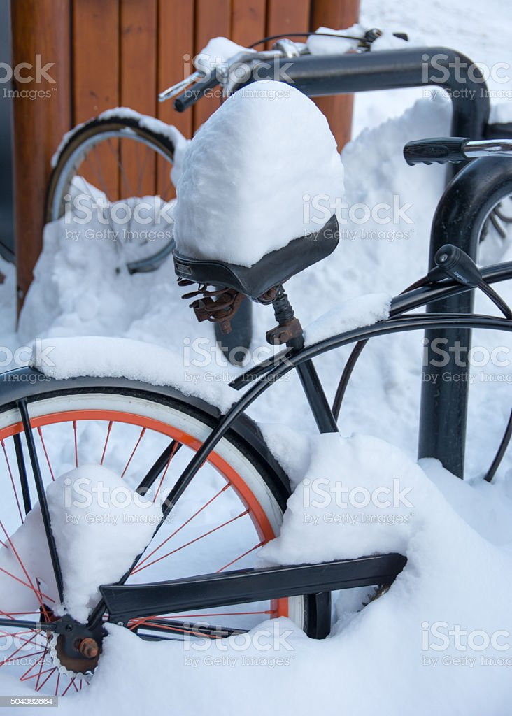 Bike sitting out after heavy snow fall stock photo