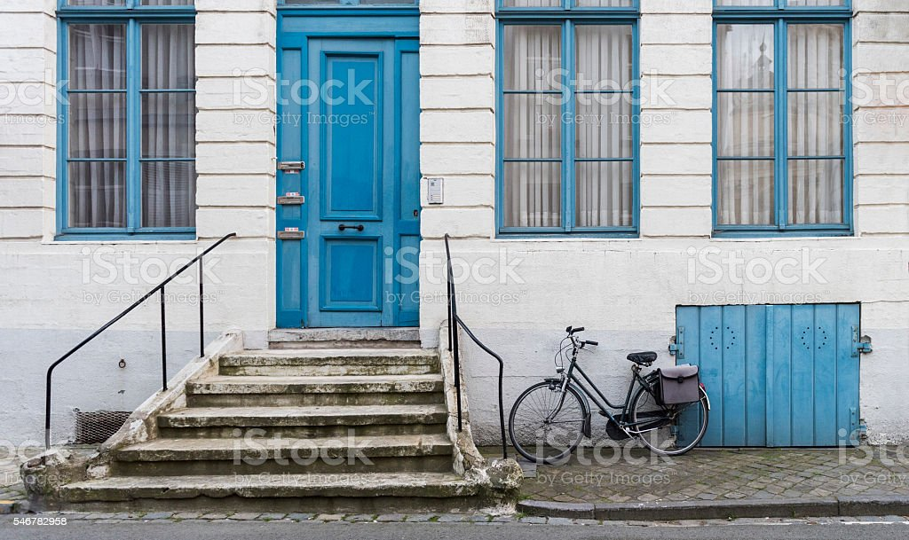 Bike standing in front of the house, Bruges stock photo