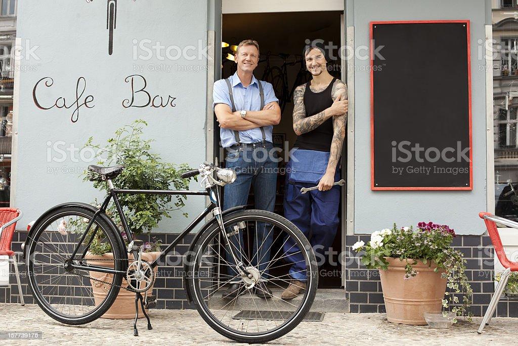 Bike Store owner and mechanic stock photo