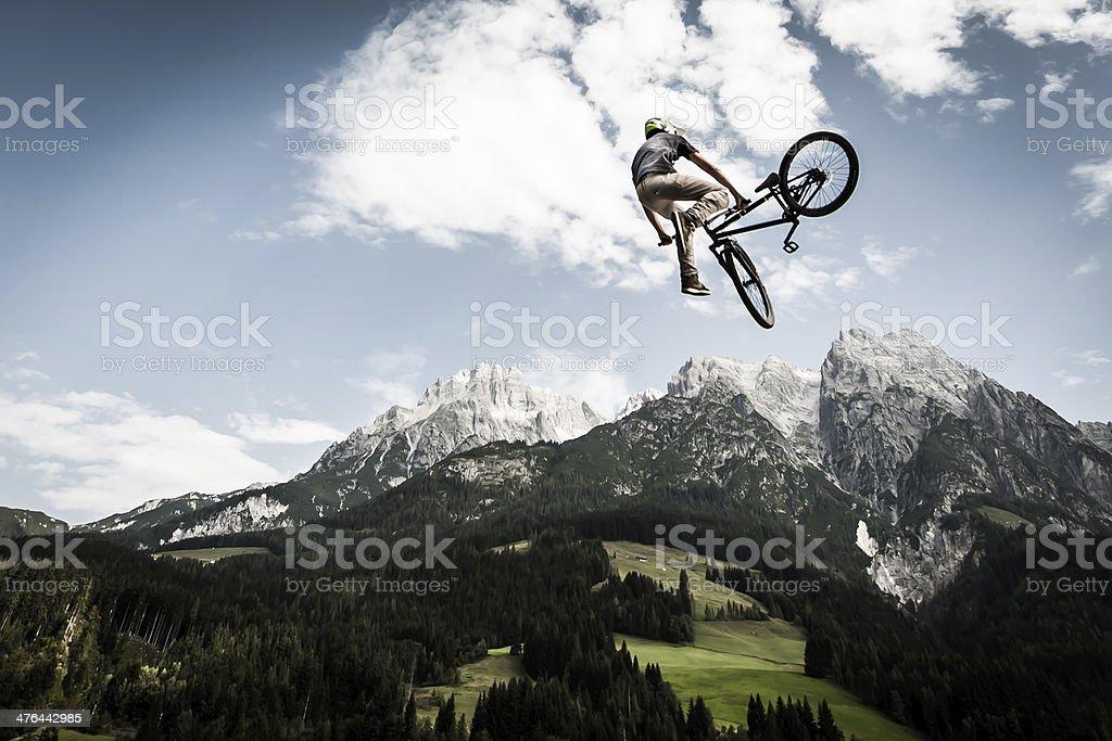 bike trick while jumping high stock photo