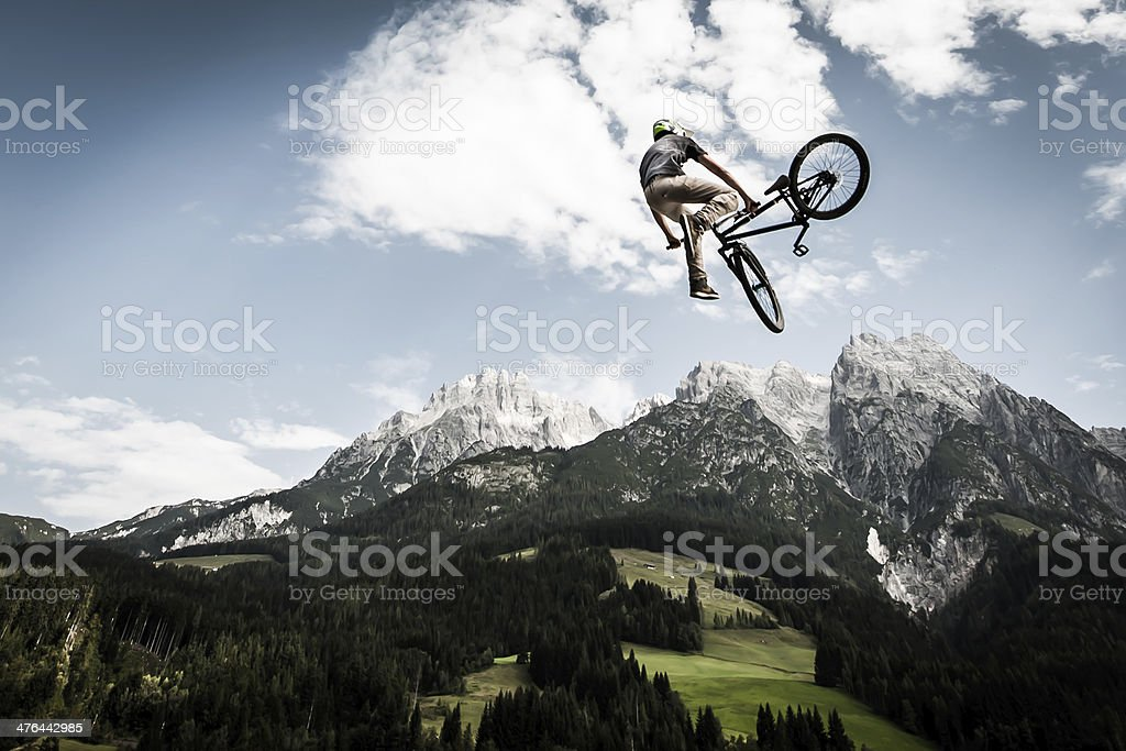bike trick while jumping high stock photo