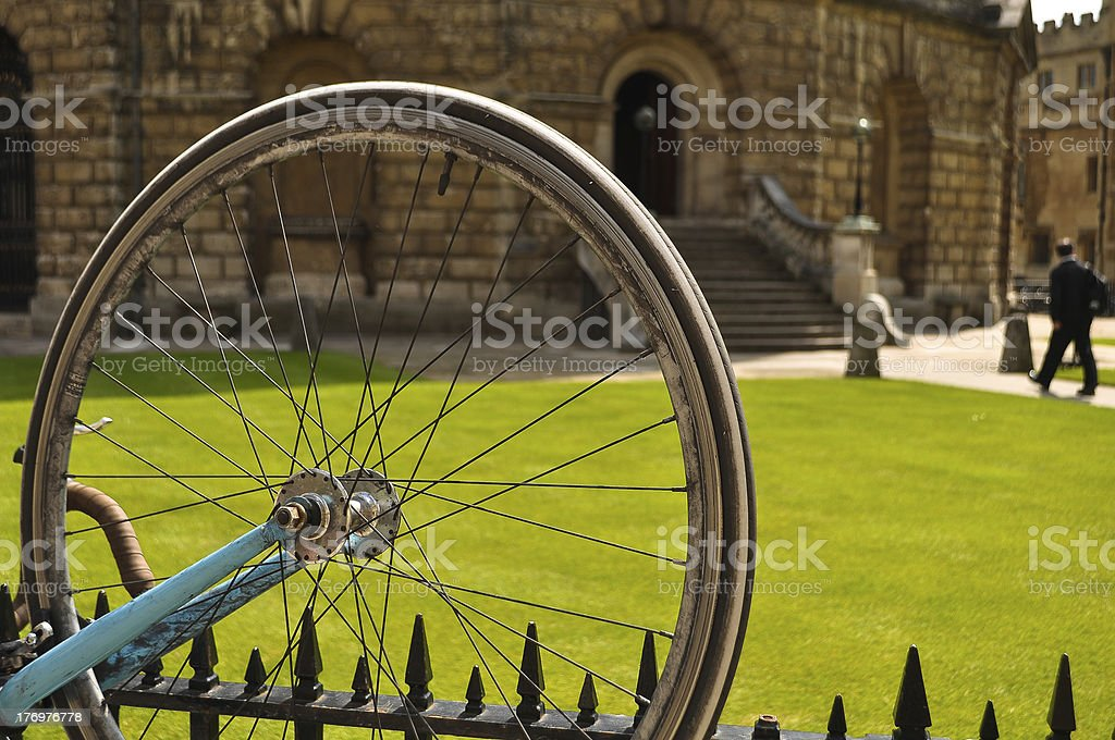 bike wheel on a fence royalty-free stock photo