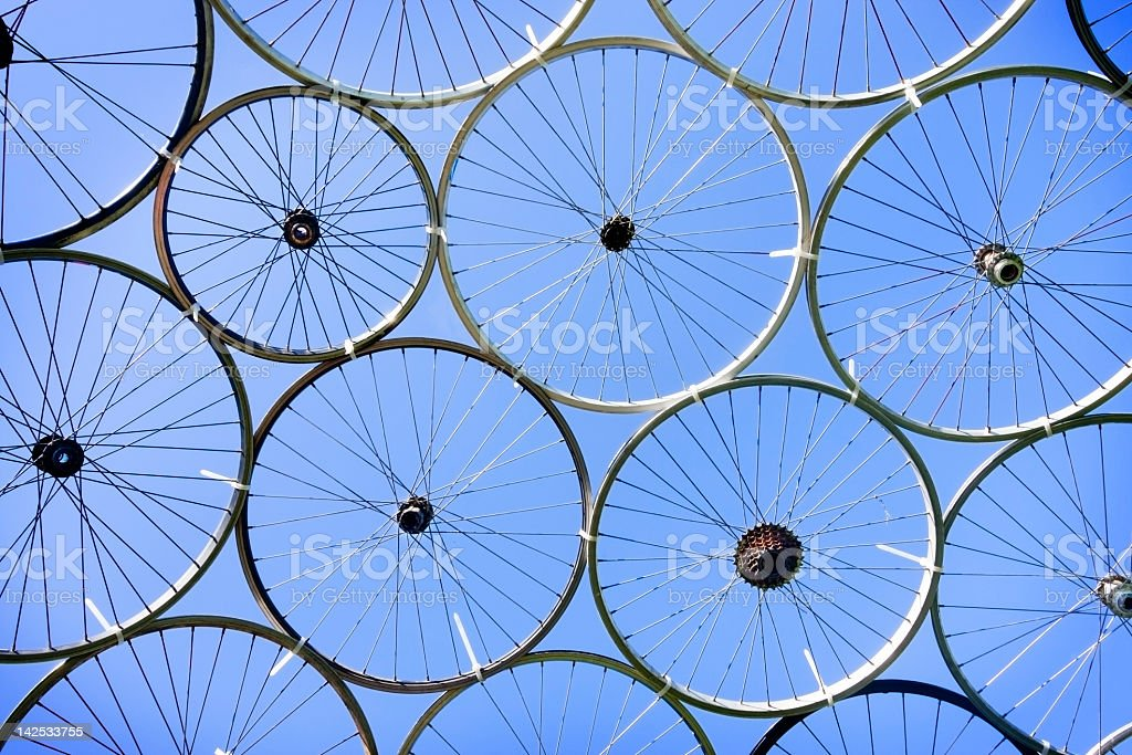 Bike Wheels tied together to make a roof stock photo