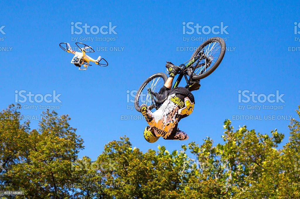 Biker blue sky jump drone stock photo