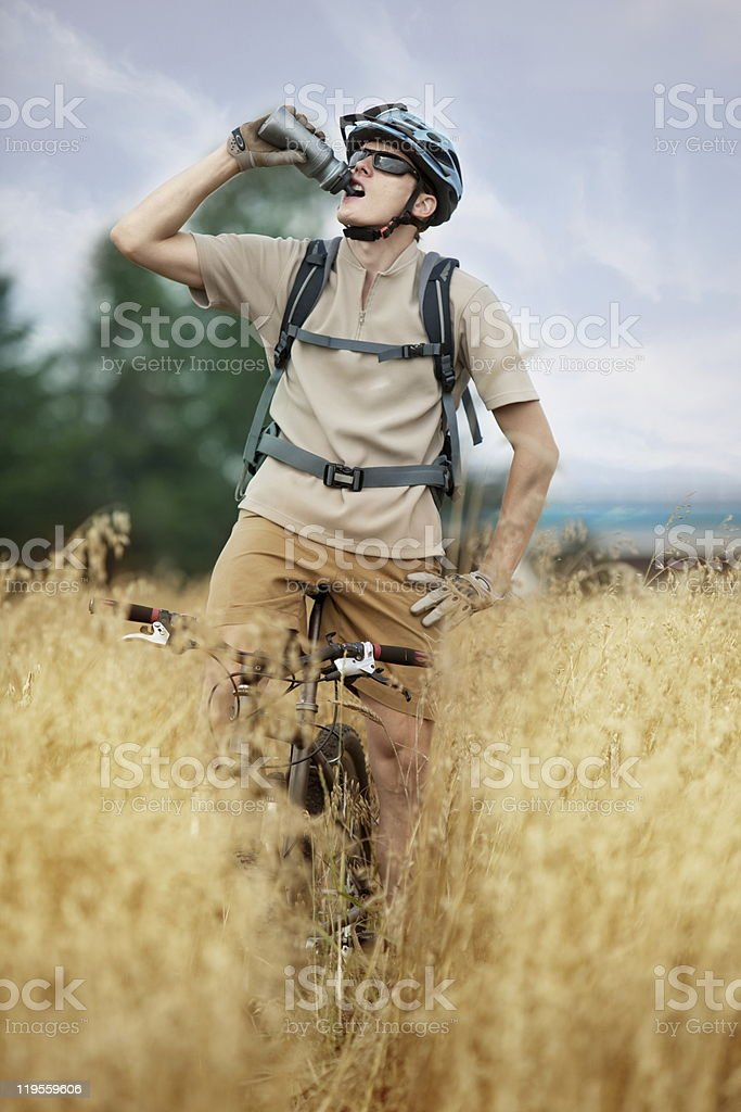 Biker drinking isotonic drink royalty-free stock photo