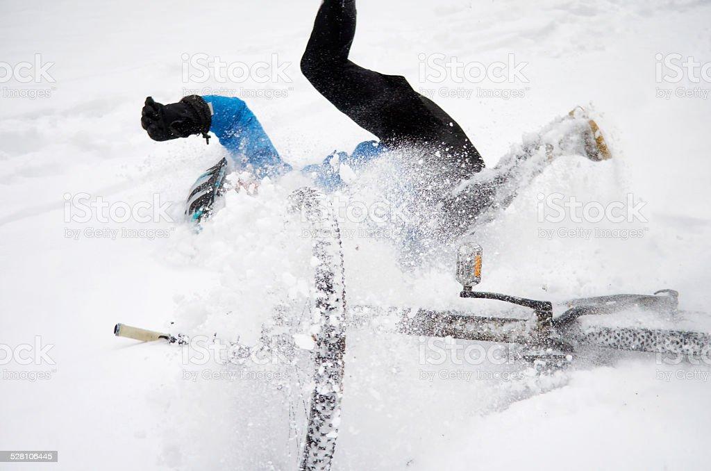 Biker falling while doing downhill. stock photo