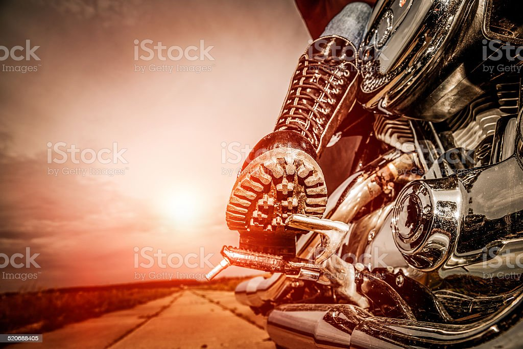 Biker girl riding on a motorcycle stock photo