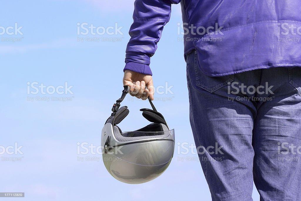 Biker holding a helmet royalty-free stock photo