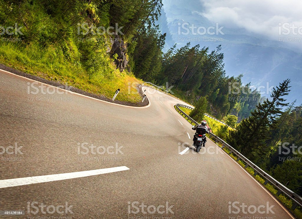 Biker in Austrian mountains stock photo