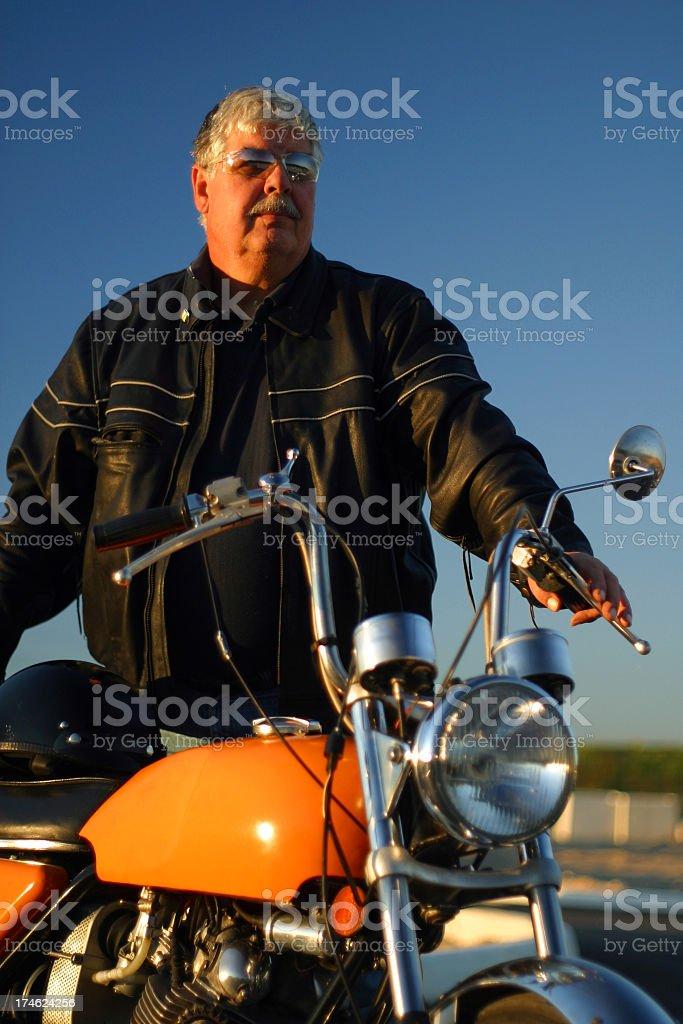 Biker In Golden Light royalty-free stock photo