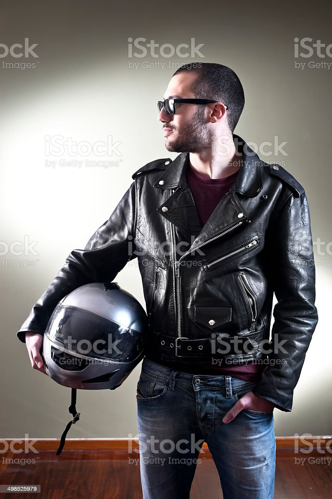 Biker in leather jacket and sunglasses stock photo