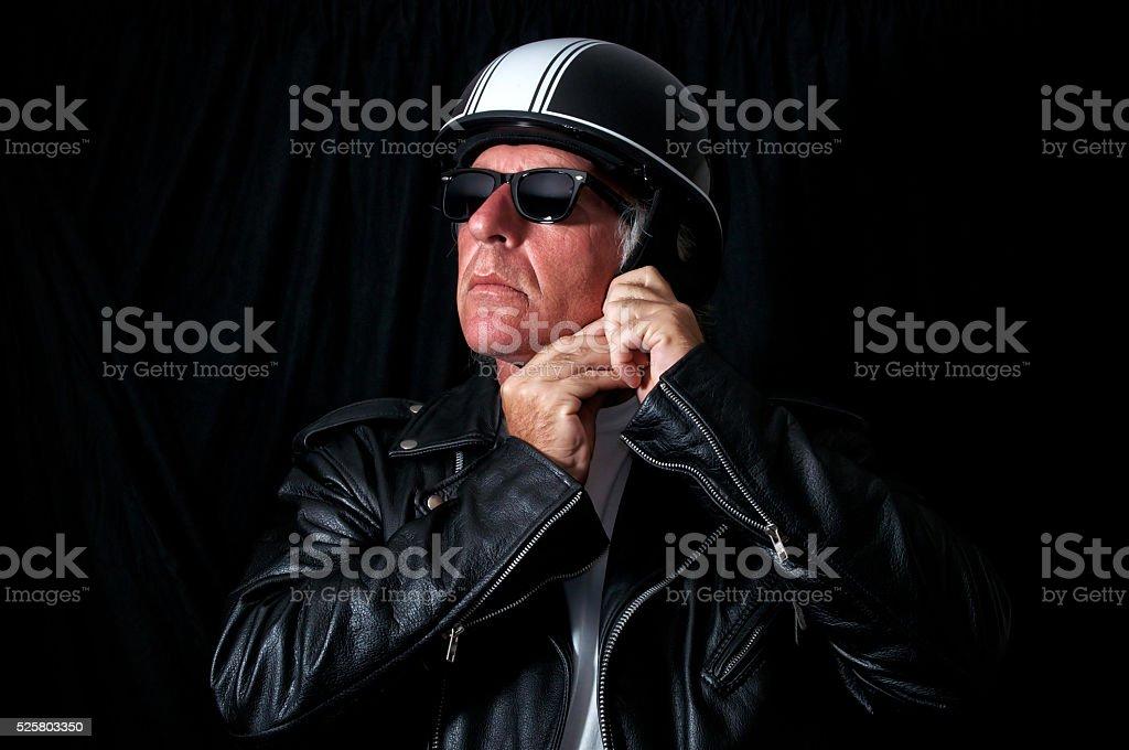 biker in leather jacket sunglasses helmet stock photo