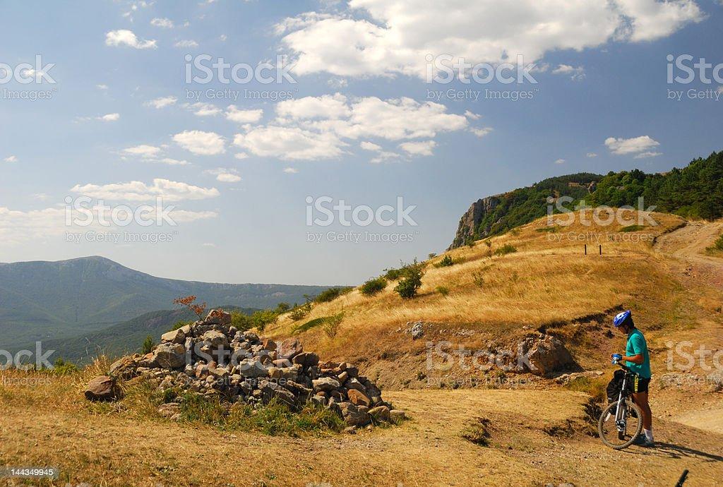 Biker in mountains stock photo