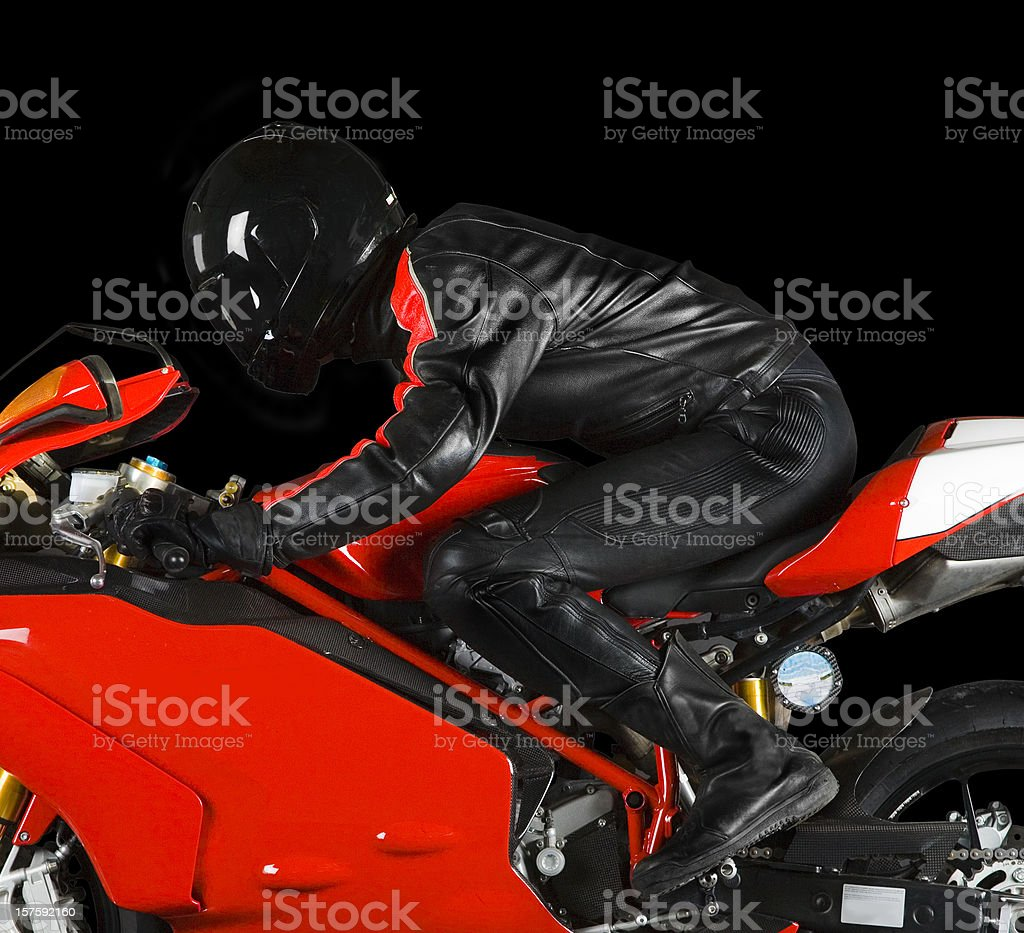 Biker in riding red superbike on black background royalty-free stock photo