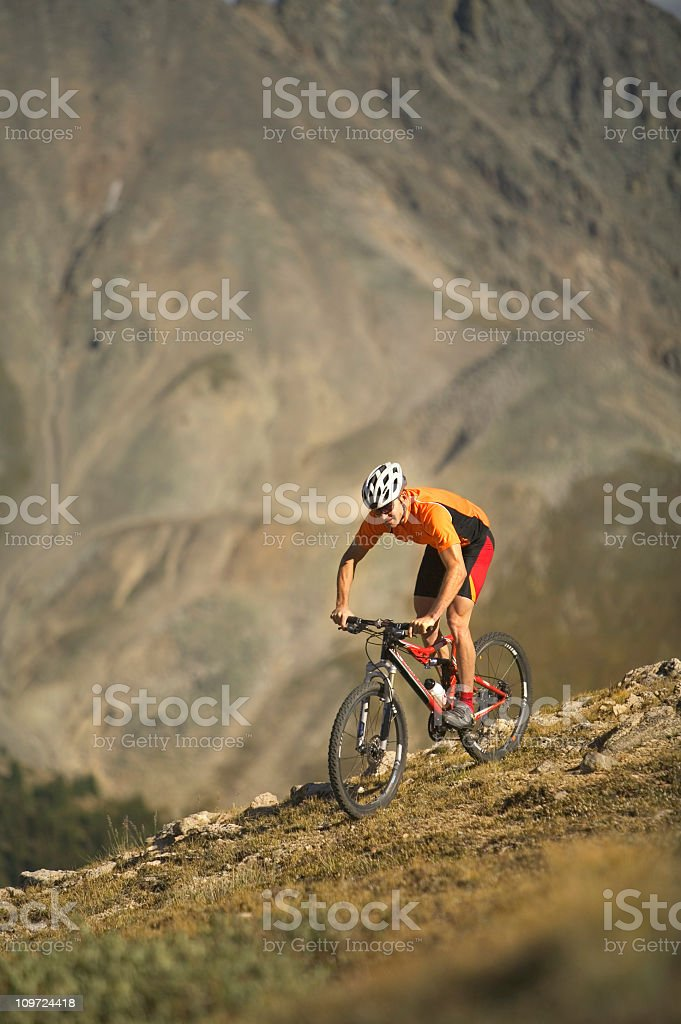 Biker in Rocky Mountains royalty-free stock photo