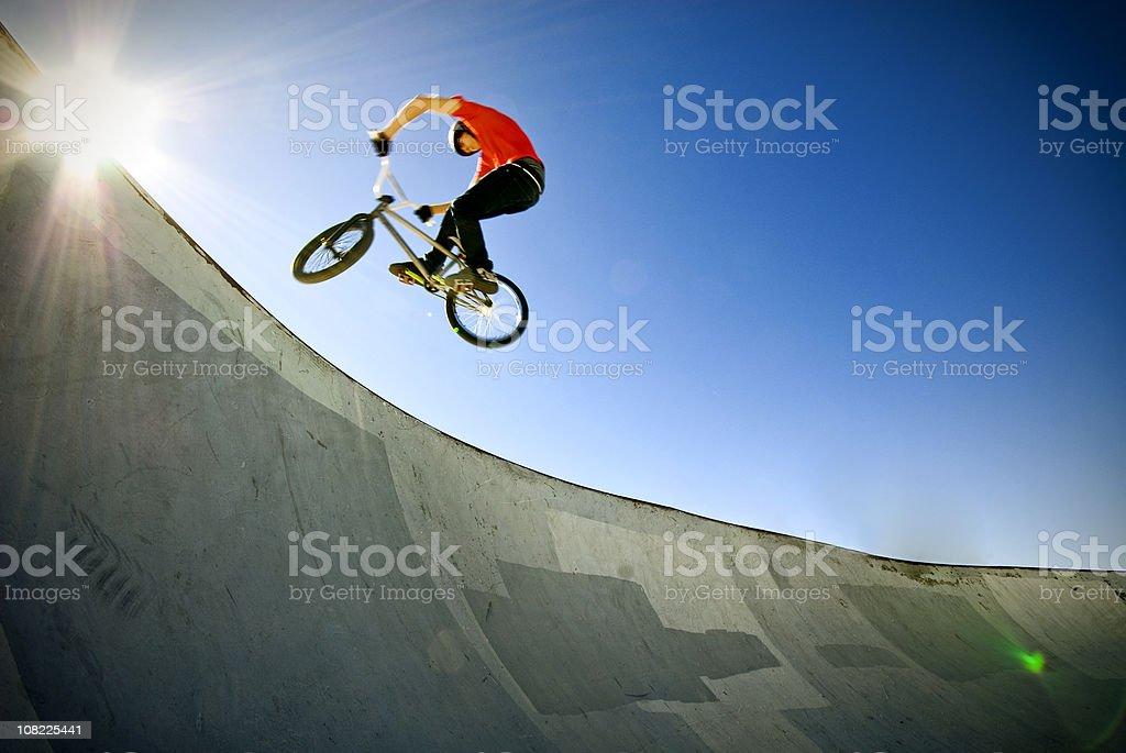 BMX biker in skate park royalty-free stock photo