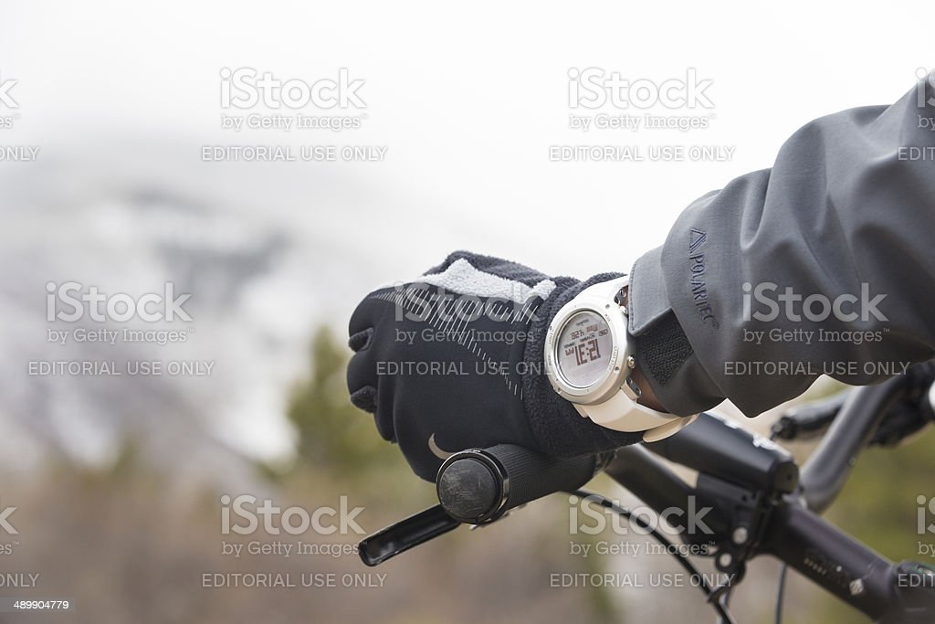 Biker in the mountains wearing a Suunto altimeter watch royalty-free stock photo