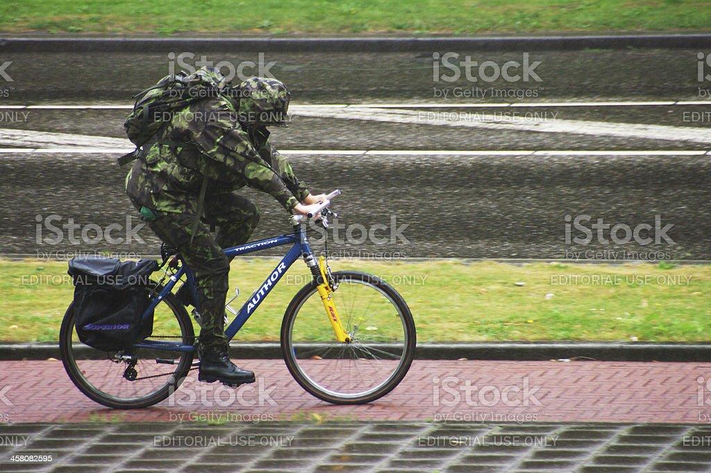 Biker in the rain stock photo