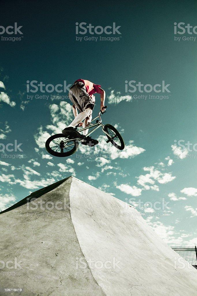 Biker Jumping at a Skate Park stock photo