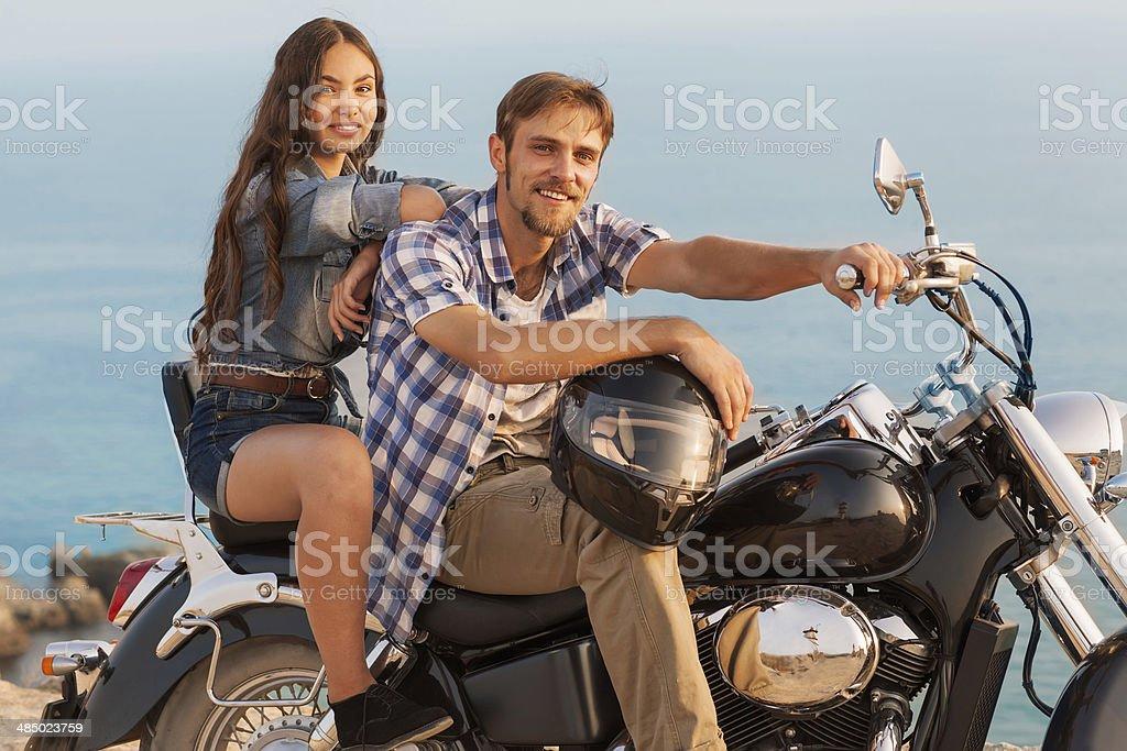 Biker man and girl stock photo