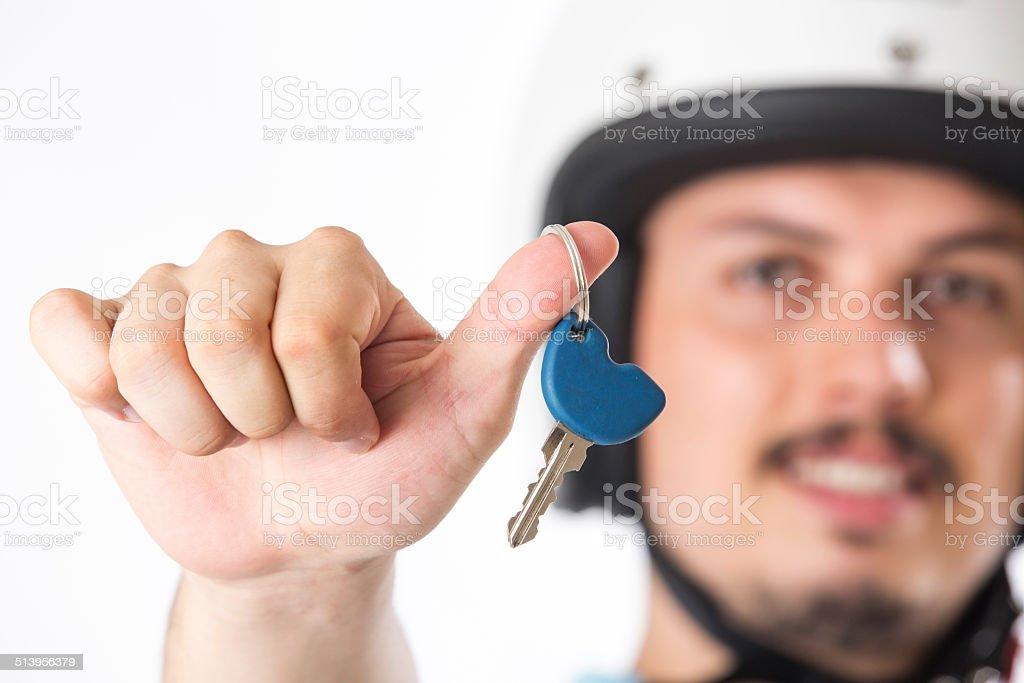 Biker man holds the key stock photo