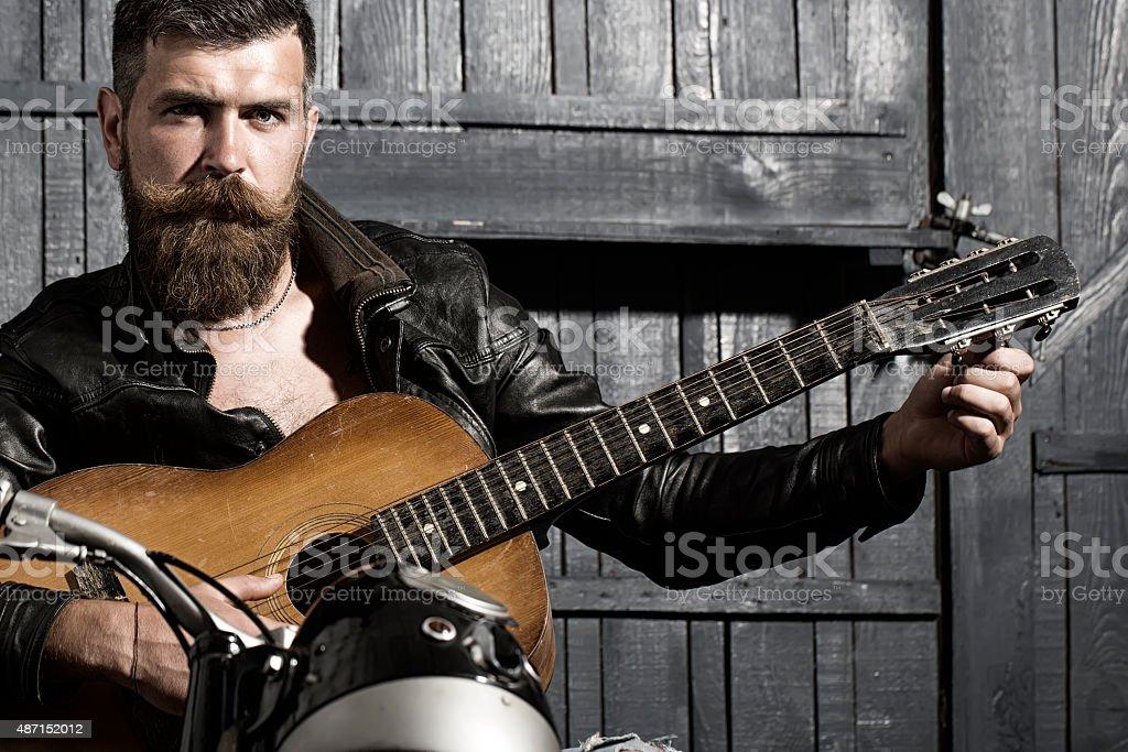 Biker man with guitar stock photo