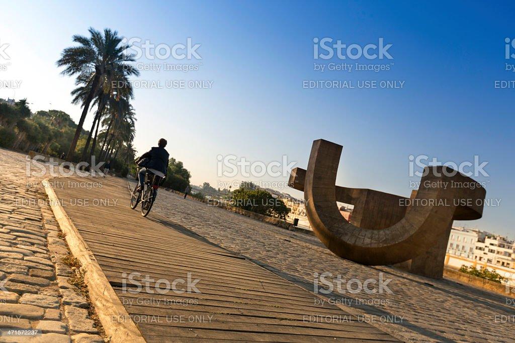 Biker near Monument Sculpture in Seville, Spain royalty-free stock photo