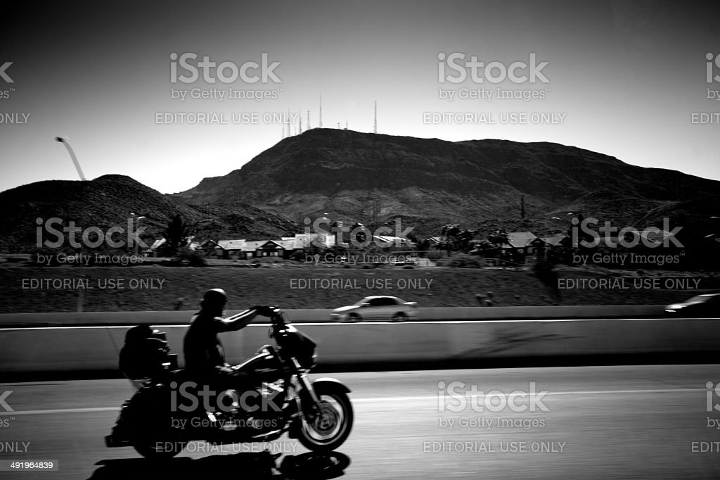Biker on a California highway stock photo