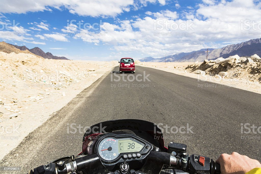 Biker on a motorcycleon the roads of Ladakh stock photo