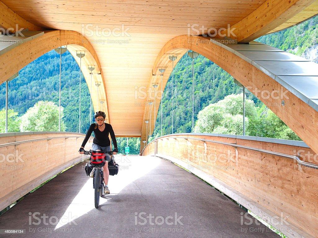 Biker on drau cycle path bridge near Aguntum ruins, Austria stock photo