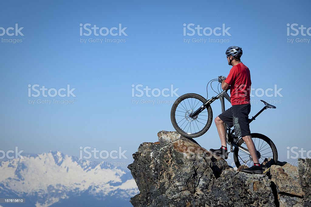 biker on top of the world. royalty-free stock photo
