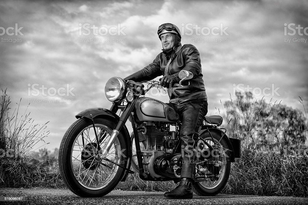 biker on vintage motorcycle stock photo