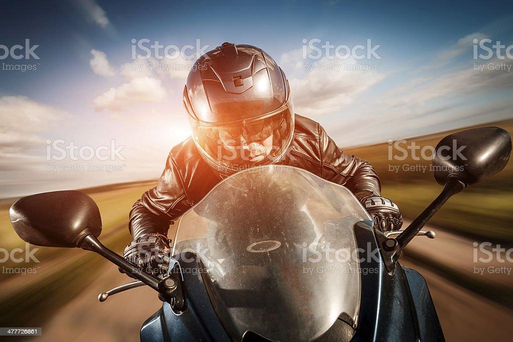 Biker racing on the road stock photo
