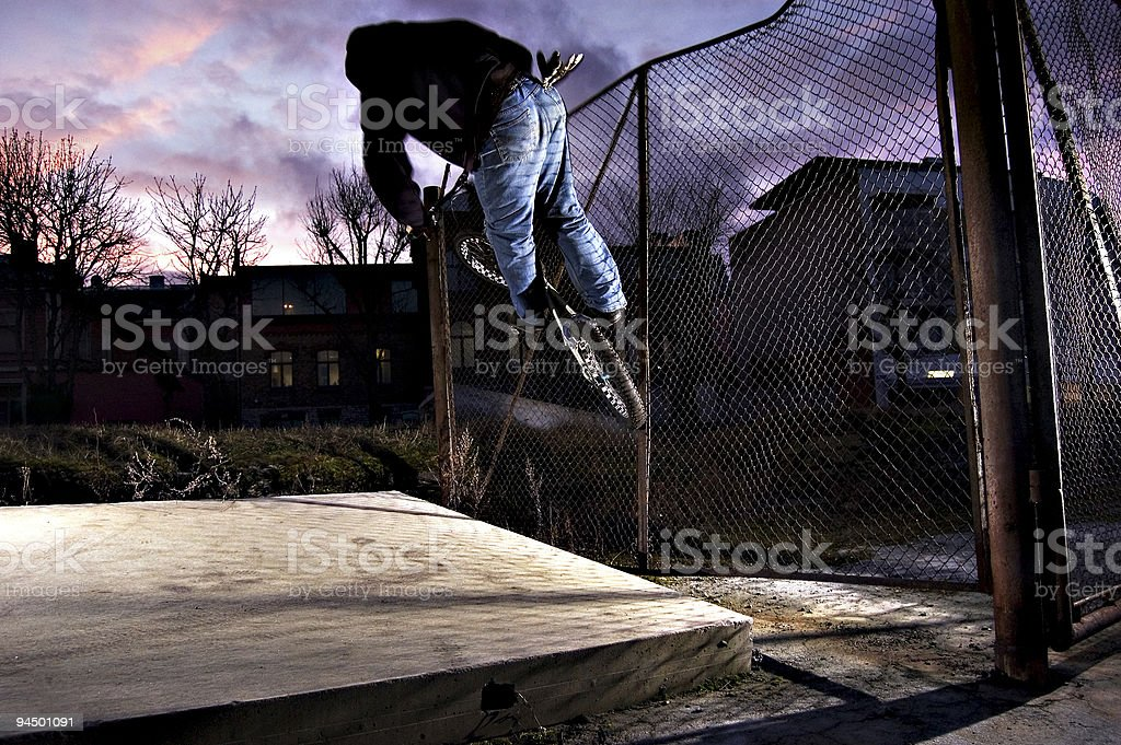 Biker rides the fence royalty-free stock photo