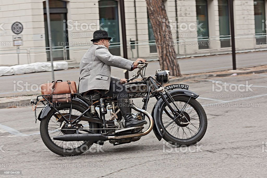 biker riding an old motorcycle NSU 501 T stock photo