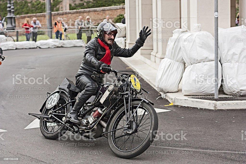 biker riding an old  motorcycle Scott TT royalty-free stock photo
