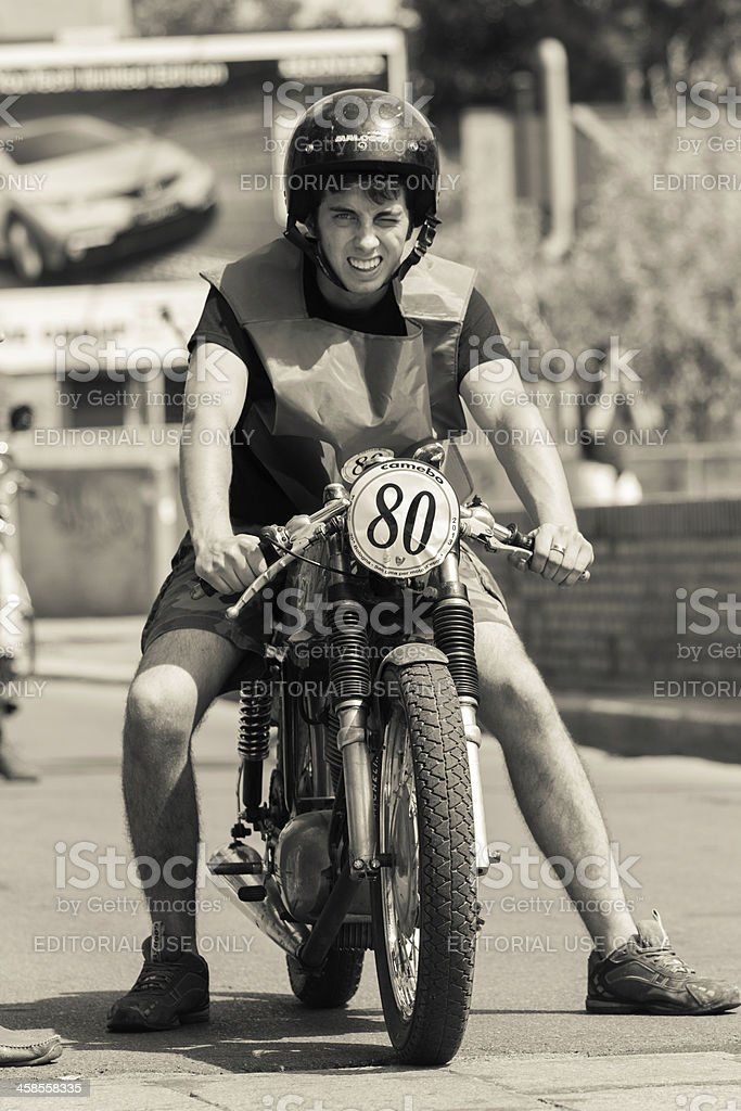Biker riding old motorcycle royalty-free stock photo