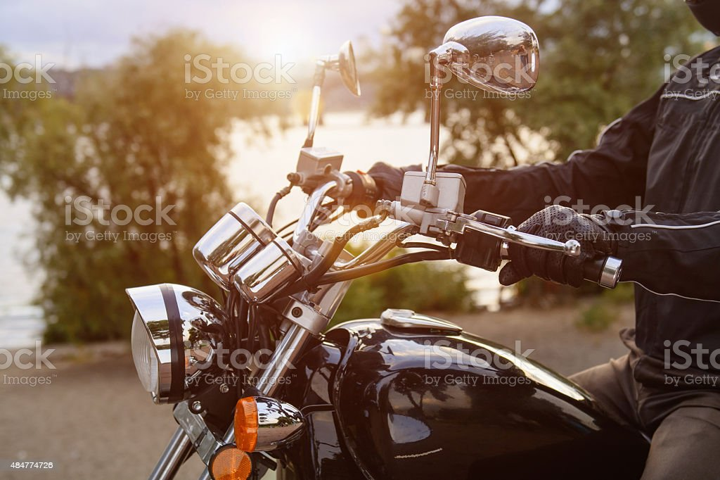 Biker riding on motorcycle in the city stock photo