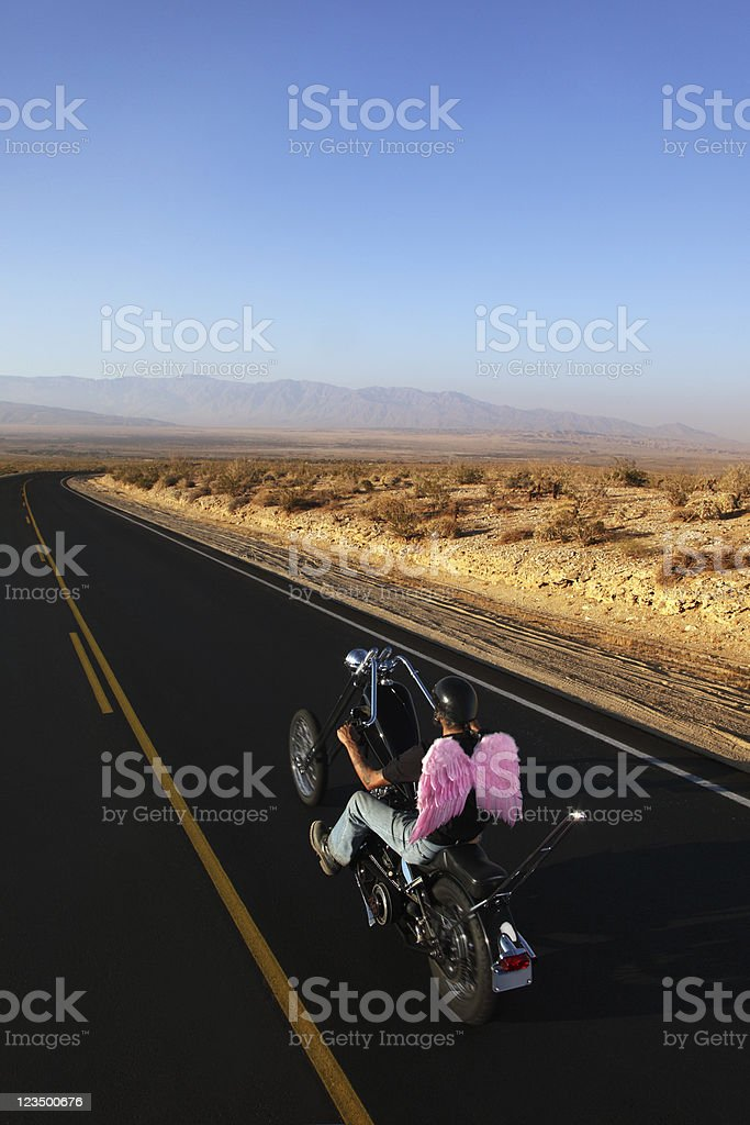 Biker Riding with Angel Wings stock photo