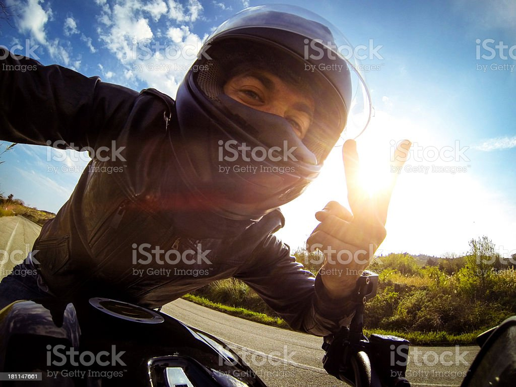 Biker say hello from his motorcycle royalty-free stock photo