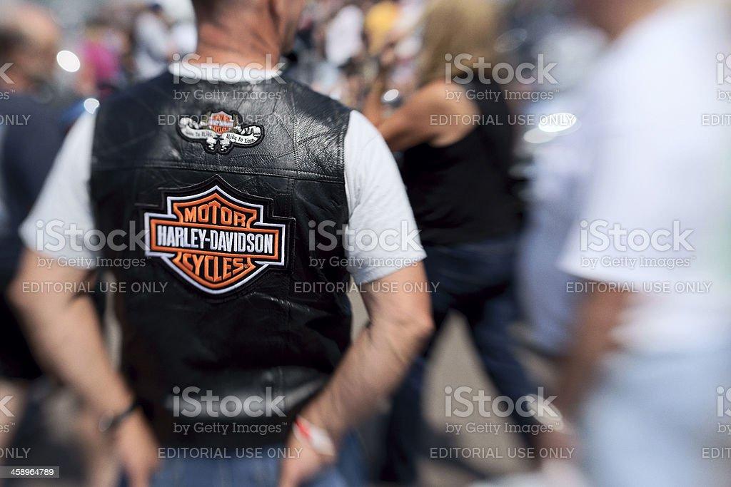 Biker wearing a Harley Davidson vest. stock photo