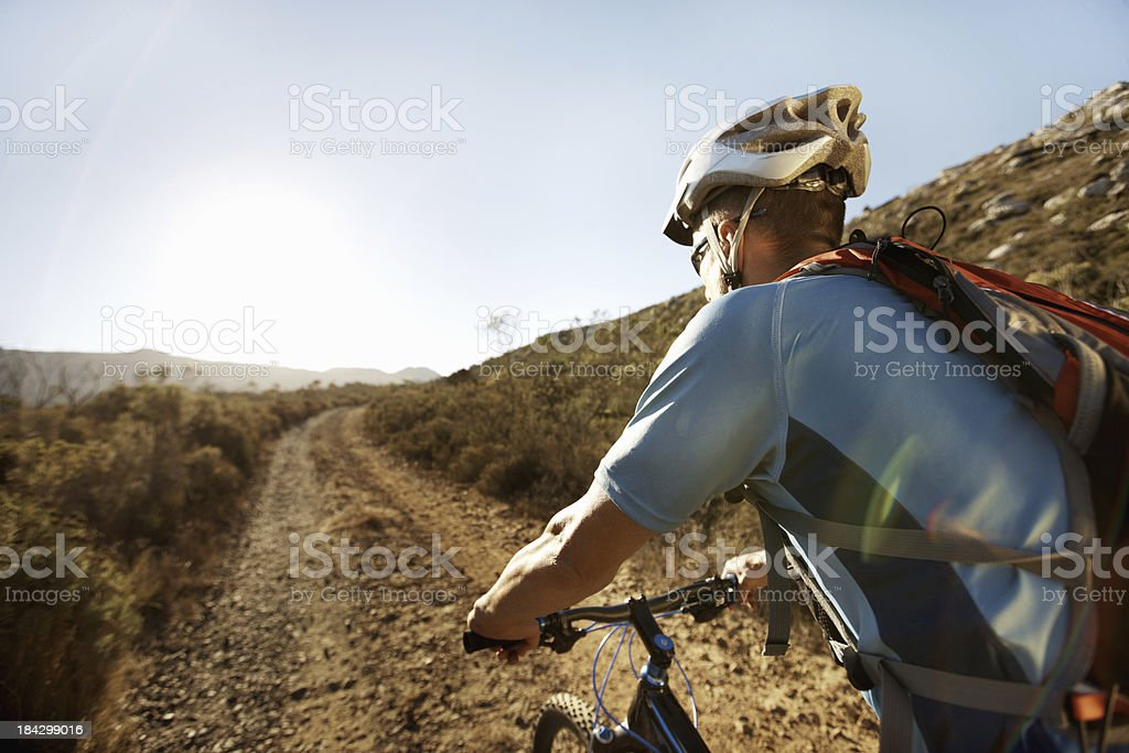 Biker wearing helmet on a cycling tour royalty-free stock photo