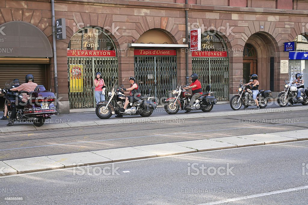 bikers enter in hotel garage stock photo