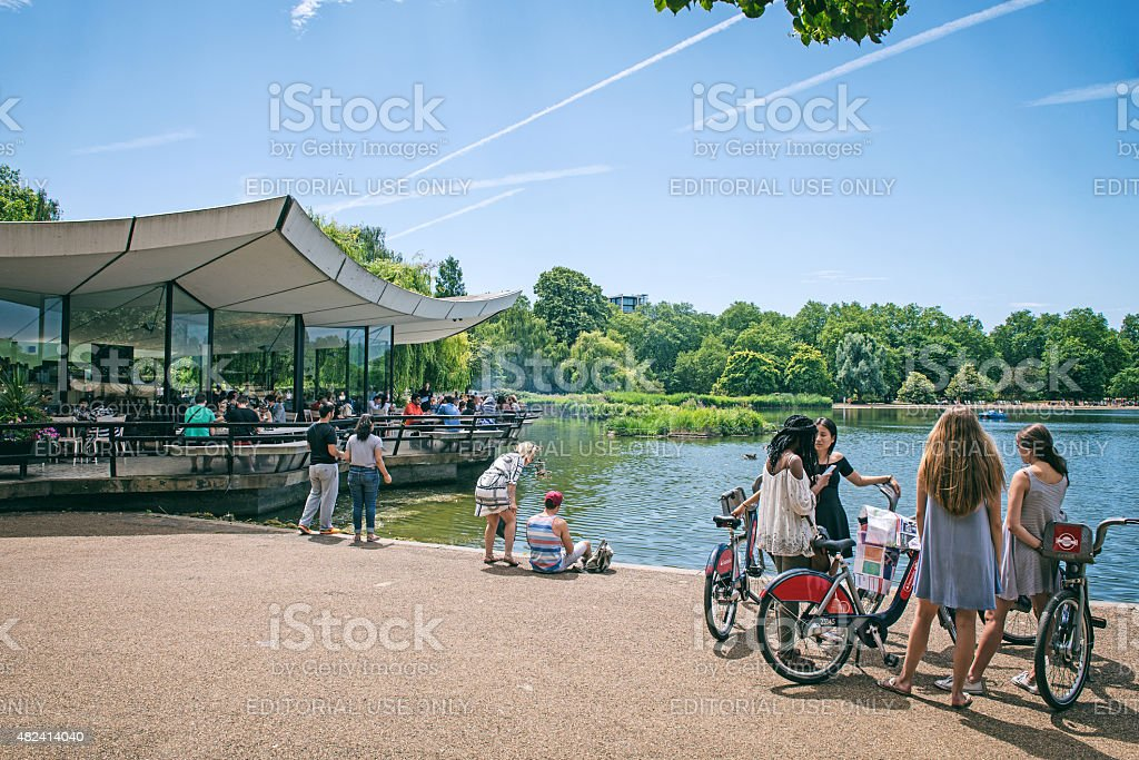 Bikers have a rest near the Serpentine in Hyde Park stock photo