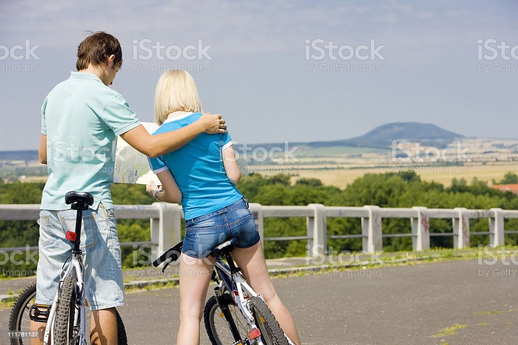 bikers holding a map royalty-free stock photo