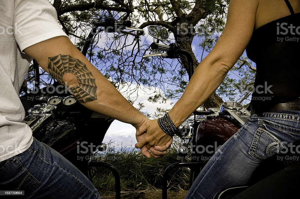 Bikers in love holding hands royalty-free stock photo