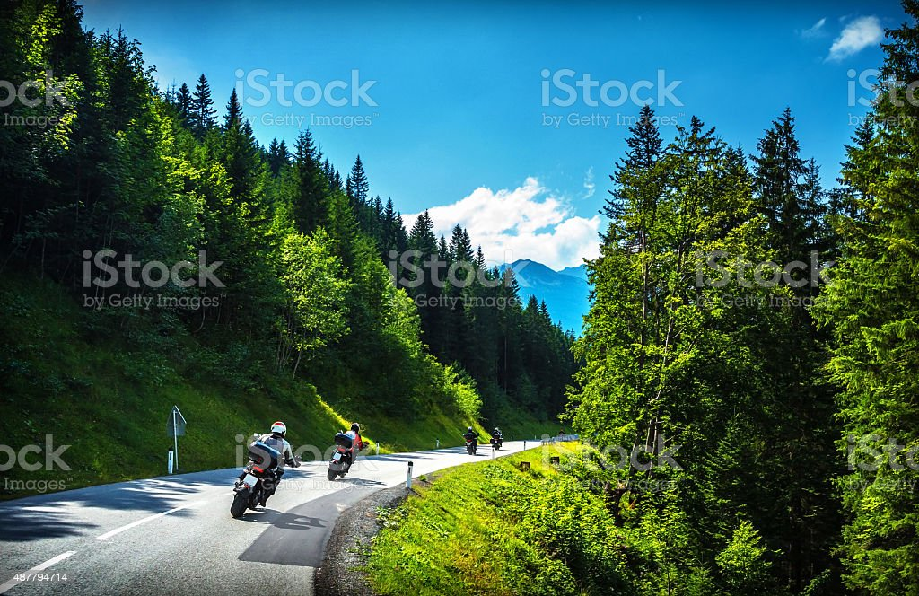 Bikers in mountainous tour stock photo